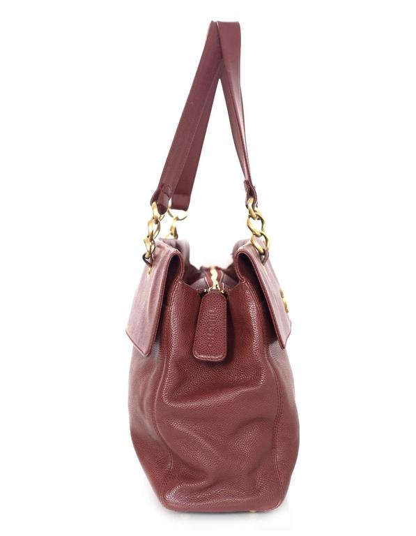Chanel Burgundy Caviar Tote  Features goldtone CC pendant on front of bag  Made In: Italy Year of Production: 2003-2004 Color: Burgundy Hardware: Goldtone Materials: Caviar leather Lining: Burgundy silk-blend fabric Closure/Opening: Zip across