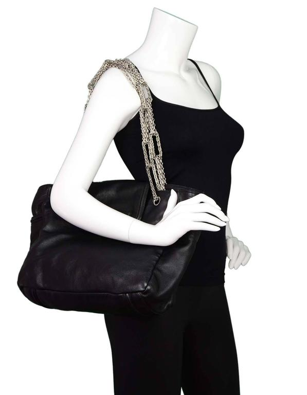 Chanel Black Leather 2.55 Reissue Lock Tote Features large reissue twist lock at front and heavy mademoiselle chain link straps  Made In: Italy Year of Production: 2008 Color: Black Hardware: Silvertone Materials: Leather, metal Lining: Grey
