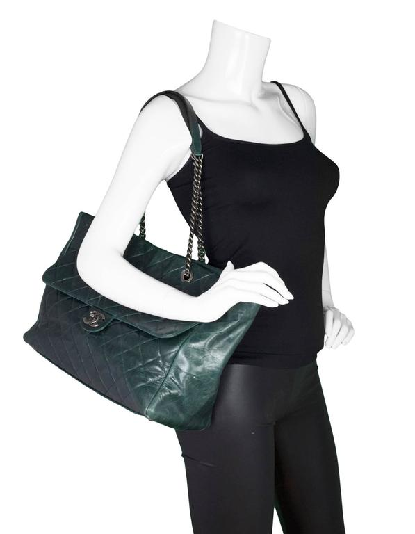 Chanel Green Distressed Leather Quilted Tote. Features front flap pocket.  Made In: Italy Year of Production: 2014 Color: dark green, silver Hardware: Ruthenium Materials: Leather, metal Lining: Burgundy grossgrain Closure/Opening: Open top with