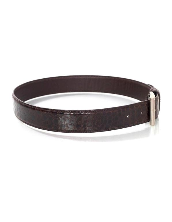 Prada Brown Crocodile Belt   Made In: Italy Color: Brown Materials: Crocodile skin Closure/Opening: Buckle and notch closure Stamp: Prada Made in Italy Crocodile Veritable 75/30 Overall Condition: Excellent pre-owned condition with the exception of