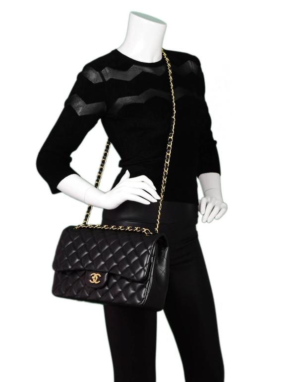 6c09c3429e2c Chanel Black Quilted Lambskin Jumbo Double Flap Bag with GHW Features  adjustable shoulder strap Made In