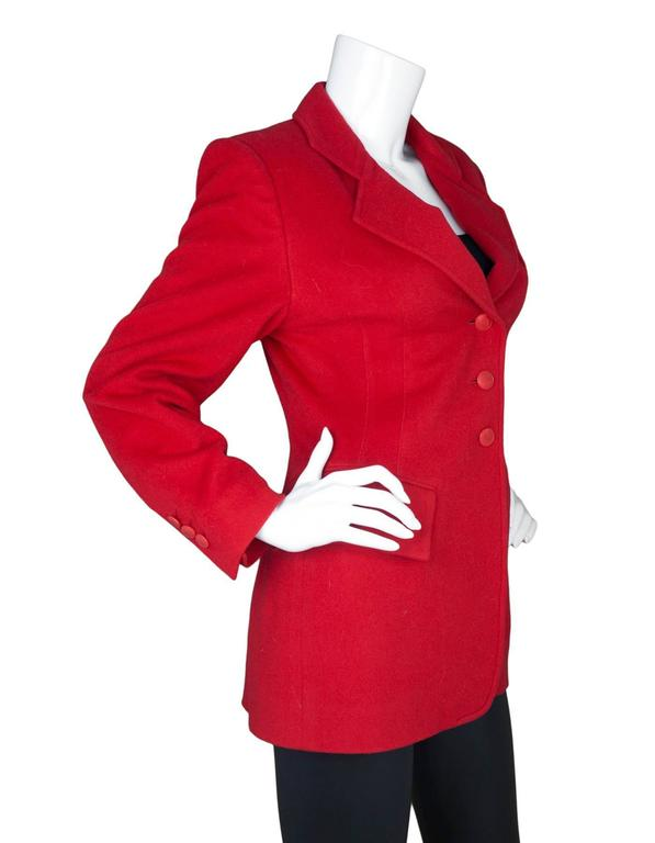 Hermes Red Cashmere Riding Jacket  Features matching red buttons with H's on them  Made In: France Color: Red Composition: 100% cashmere Lining: Red, 100% acetate Closure/Opening: Button down front Exterior Pockets: One breast pockets and two hip