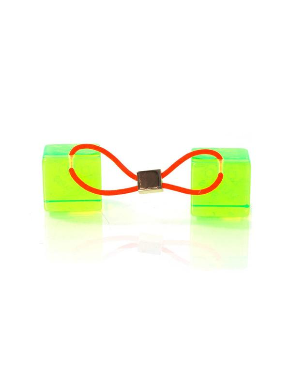 "Louis Vuitton Green Hair Cubes  Color: Green Hardware: Goldtone Materials: Lucite, brass, elasticized band Retail Price: $295 + tax Overall Condition: Excellent pre-owned condition with the exception of some surface marks  Measurements:  1""L x"