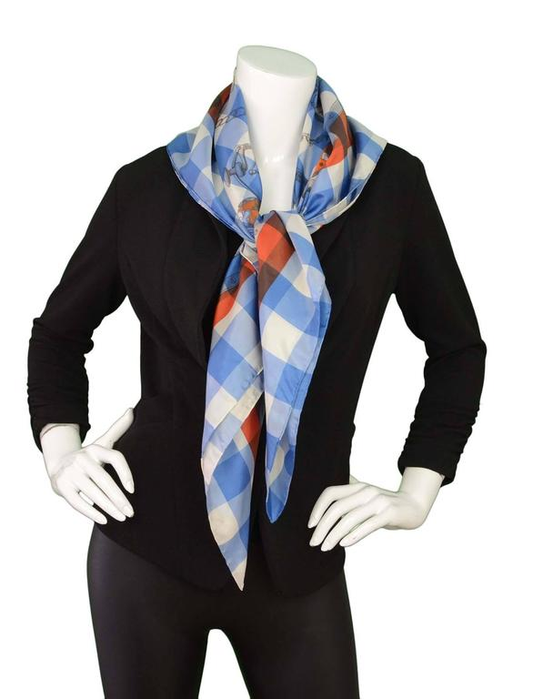 """100% Authentic Hermes 40"""" Mors & Gourmettes Scarf.  Features riding accessory print  a top of blue and white gingham print with and orange border.  Made In: India Color: Blue, White, Orange Composition: 100% Silk Overall Condition: Excellent,"""