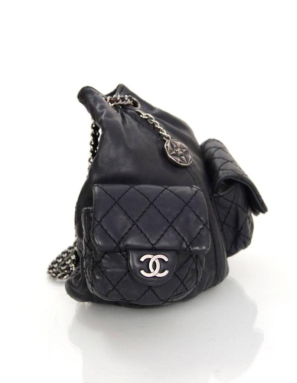 Chanel Black Quilted Mini 'Backpack is Back' Bag  Features CC charm at front zipper pull and two CC pendants on pockets  Made In: Italy Year of Production: 2012 Color: Black Hardware: Oxidized silvertone Materials: Calfskin leather Lining: Black