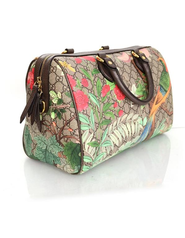 abc4092ab210 Gucci Monogram Tian Supreme Boston Bag Features features flowers and bird  printed over monogram Made In