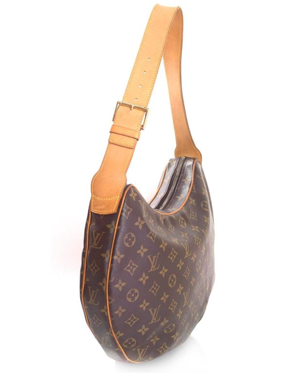 f3f87a1cae2a Louis Vuitton Monogram Croissant GM Bag Features adjustable leather handles  and leather piping Made In