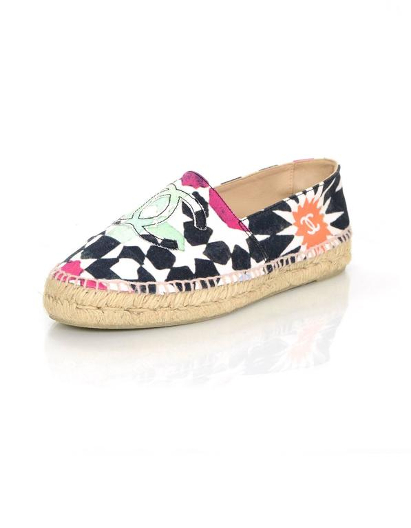 27ab2a5c4 Chanel Multi-Colored Star Print Canvas Espadrilles Features multi-colored  CC's stitched on toe