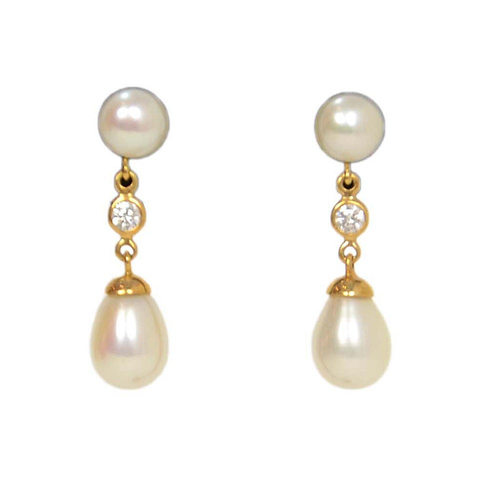 and co pearl gold tear drop earrings at