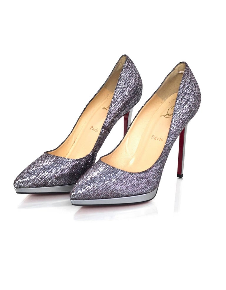 Christian Louboutin Silver Glitter Pigalle Plato 120 sz 41  Made In: Italy Color: Silver 624/ Anthracite 1 Materials: Leather & textile Closure/Opening: Slide on Sole Stamp: Christian Louboutin MADE IN ITALY 41 Retail Price: $675 + tax Overall