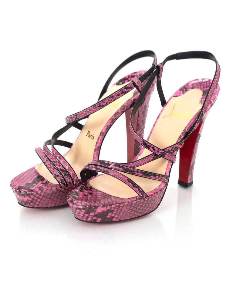 Christian Louboutin Pink Python Miss Dina 120 Sandals sz 40. Features strappy detail and platform heel.  Made In: Italy Color: Pink and black Materials: Python snake skin and leather Closure/Opening: Slide on with elastic ankle strap Sole Stamp: