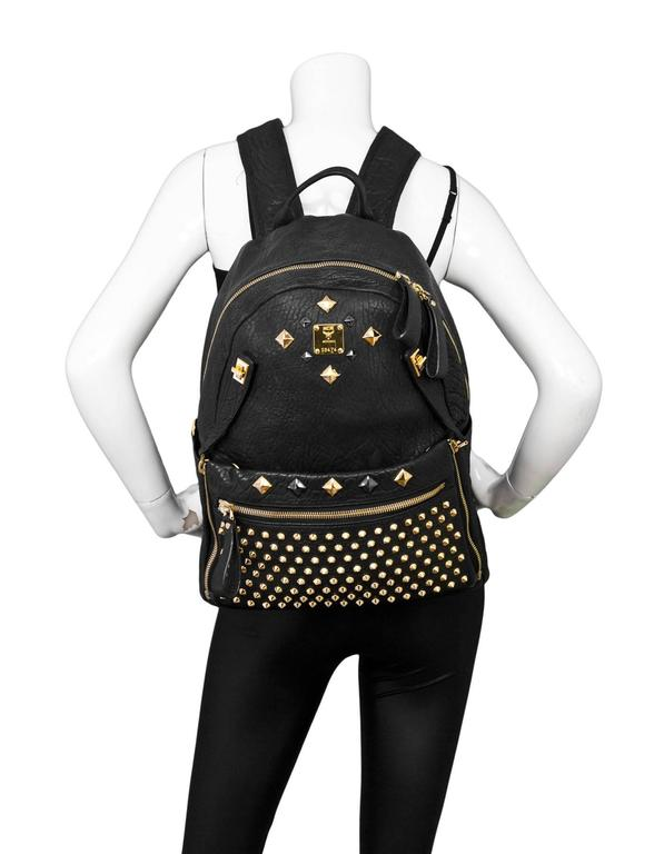 e3c7ac900ab0 MCM Black  amp  Gold Studded Large Dual Stark Backpack Front studded pocket  can be zipped