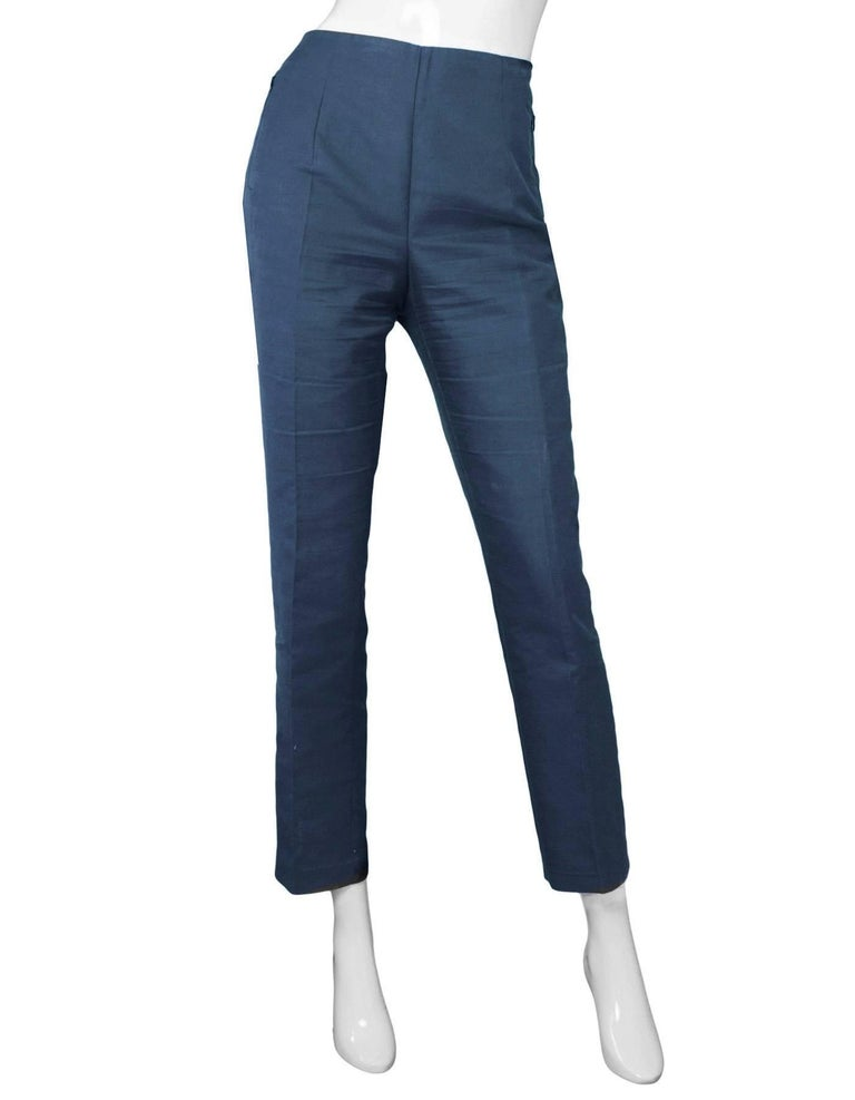 Akris Navy Cropped Pants Sz 10  Made In: Romania Color: Green Composition: 59% cotton, 39% silk, 2% nylon Lining: None Closure/Opening: Hidden side zip and button closure Exterior Pockets: Zip pockets at hips Overall Condition: Very good pre-owned