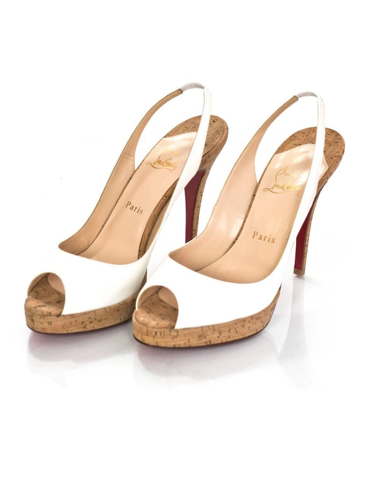 Christian Louboutin White Patent & Cork Peep-Toe Pumps Sz 38.5  Made In: Italy Color: White, tan Materials: Patent leather, cork Closure/Opening: Slingback strap Sole Stamp: Christian Louboutin MADE IN ITALY 38.5 Overall Condition: NEW Includes: