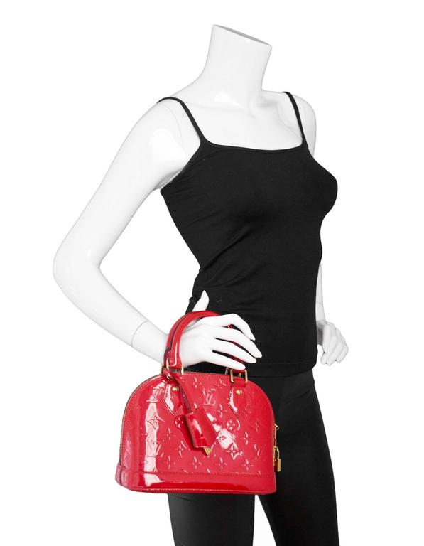 699cc6b88c62 Louis Vuitton Red Vernis Alma BB Bag Features optional crossbody strap Made  In  France Year