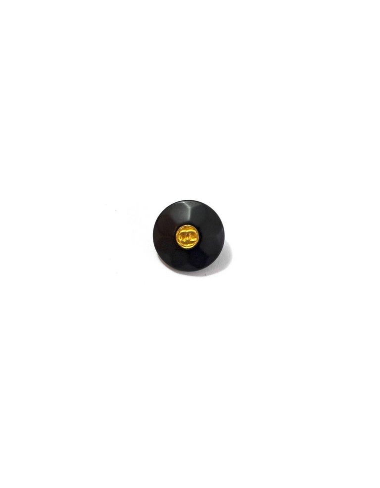Chanel Black Textured Buttons with goldtone CC at center Features 5 18mm buttons  Color: Black, gold Hardware: Goldtone Materials: Resin, metal Stamp: Chanel Overall Condition: Very good good pre-owned condition, light surface marks Measurements: