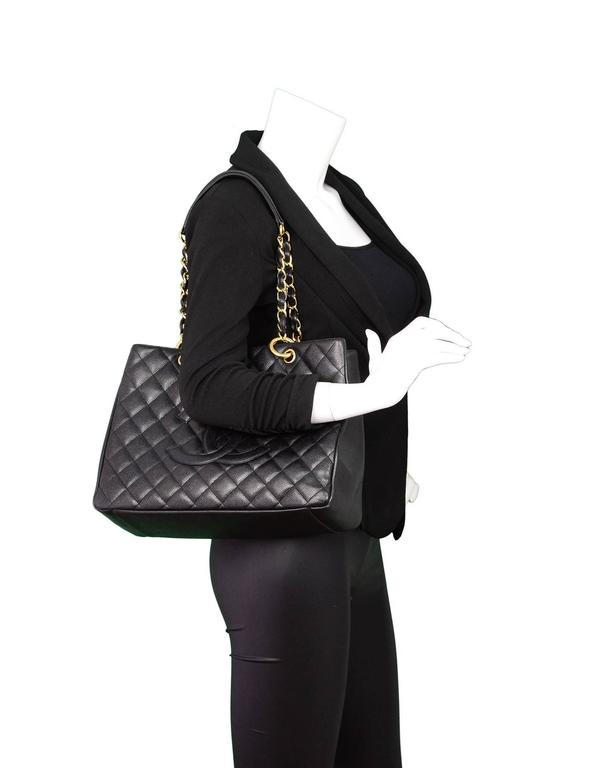 5bba13a0b3df Chanel Black Caviar Grand Shopper Tote Features timeless CC at front - This  is a