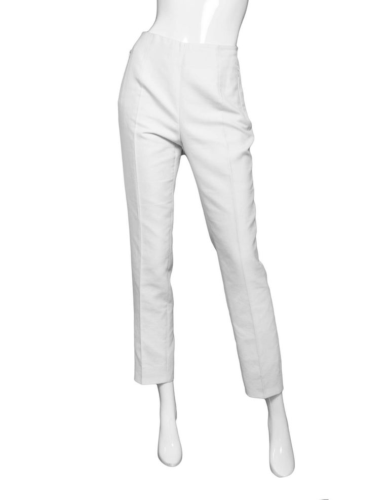 Akris White Cropped Pants Sz 8  Made In: Romania Color: White Composition: 59% cotton, 39% silk, 2% nylon Lining: None Closure/Opening: Hidden side zip and button closure Exterior Pockets: Zip pockets at hips Overall Condition: Very good pre-owned