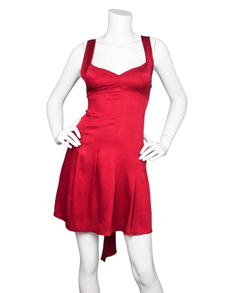 Moschino Brick Red Dress Sz US4 Features bow detail at back  Made In: Italy Color: Brick red Composition: Not listed, feels like silk Lining: Red underslip Closure/Opening: Hidden side zip closure Overall Condition: Excellent pre-owned condition,