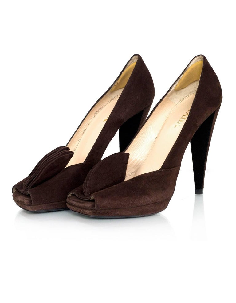 Prada Brown Suede Square Peep-Toe Pumps  Features pedals at peep-toe  Made In: Italy Color: Brown Materials: Suede Closure/Opening: Slip on Sole Stamp: Prada 37 Made in Italy Overall Condition: Excellent pre-owned condition with the exception of