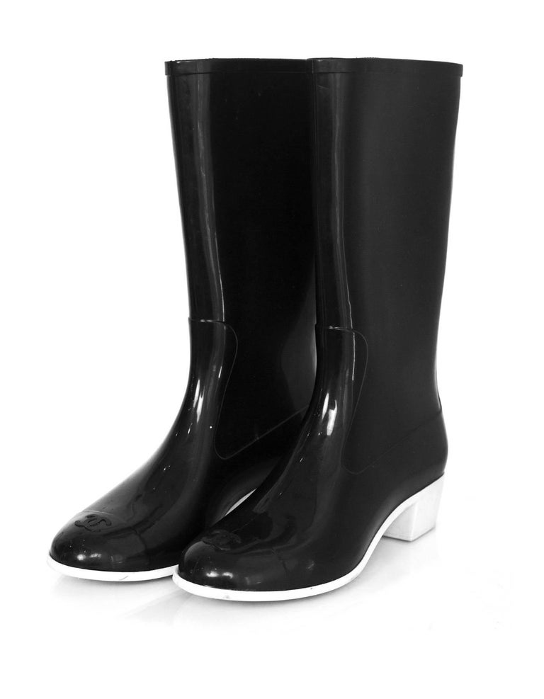 Chanel Black and White Rain Boots Sz 40 Features CC at toes  Made In: Italy Color: Black and white Materials: Rubber Closure/Opening: Pull on Sole Stamp: CC 40 made in italy Overall Condition: Excellent pre-owned condition with the exception of