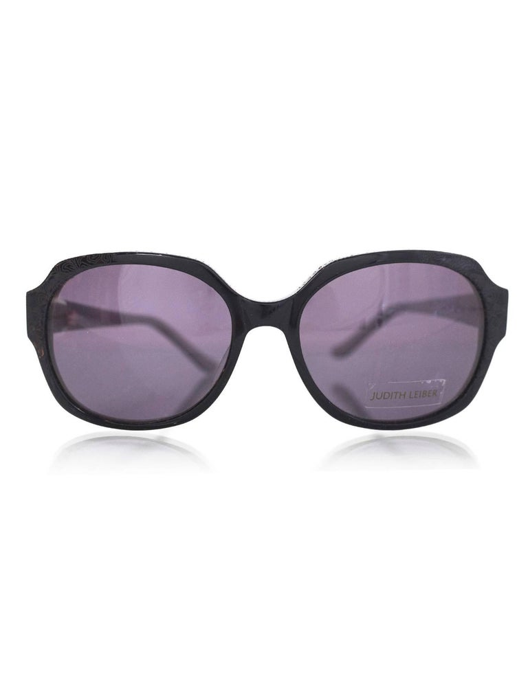 Judith Leiber Black Swarovski Crystal Sunglasses Features crystals at top of frame and arms and floral laser-etched design  Made In: Japan Color: Black Materials: Resin, crystal Retail Price: $420 + tax Overall Condition: Excellent pre-owned