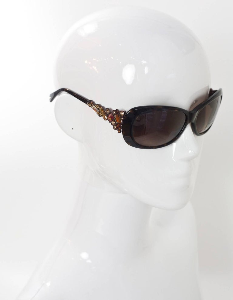 Judith Leiber Brown Tortoise Swarovski Crystal Sunglasses Features topaz crystals at arms  Made In: Japan Color: Brown/tortoise Materials: Resin, crystal Retail Price: $620 + tax Overall Condition: Excellent pre-owned condition Includes: Judith