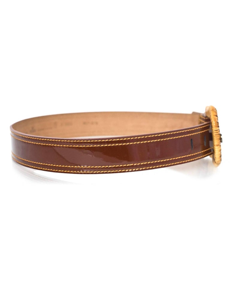 Fendi Brown Patent & Wicker Belt  Features wicker wrapped belt buckle   Made In: Italy Color: Brown and tan Hardware: Wicker and bronze Materials: Patent leather and wicker Closure/Opening: Buckle and notch closure Stamp: 8C0303 WCT-078 Overall