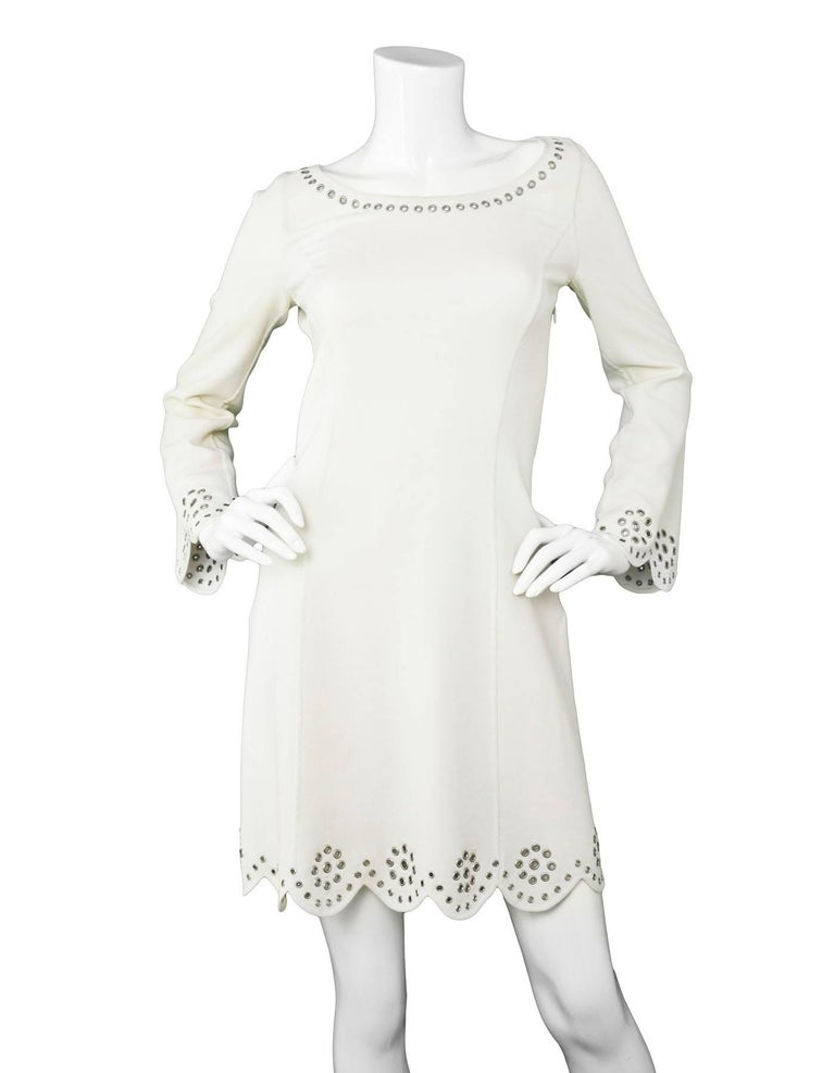 Michael Kors White Longsleeve Grommet Dress Sz 2  Made In: Italy Color: White Composition: Not given- believed to be a poly-blend Lining: None Closure/Opening: Hidden side zip up Exterior Pockets: None Interior Pockets: None Overall Condition: Very