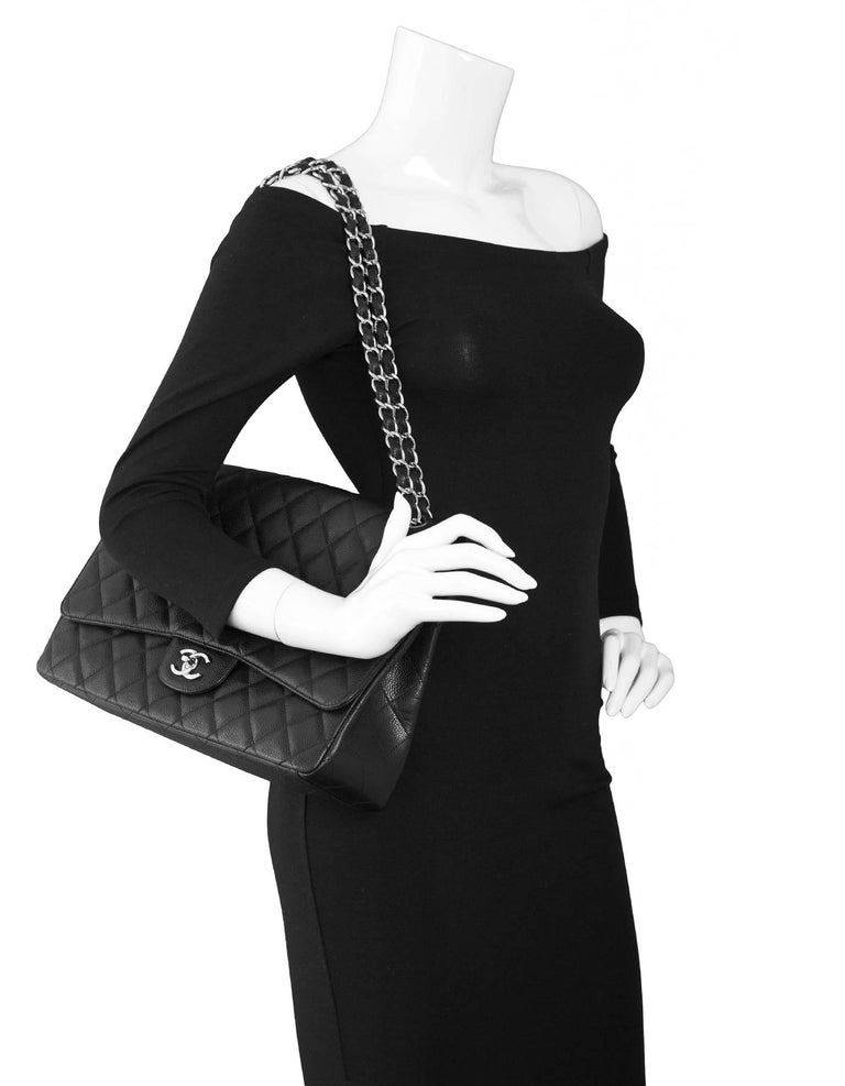 Chanel Black Quilted Caviar Classic Flap Maxi Bag Features adjustable shoulder strap  Made In: Italy Year of Production: 2009-2010 Color: Black Hardware: Silvertone Materials: Caviar leather, metal Lining: Black leather Closure/Opening: Flap top