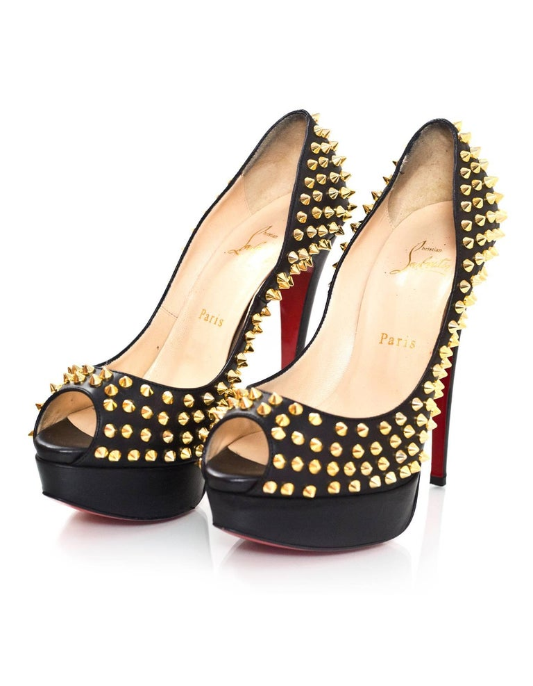 Christian Louboutin Black & Gold Lady Peep Spikes 150 Pumps Sz 38.5  Made In: Italy Color: Black, gold Materials: Leather, metal Closure/Opening: Slide on Sole Stamp: Christian Louboutin Made in Italy 38.5 Retail Price: $1,395 + tax Overall