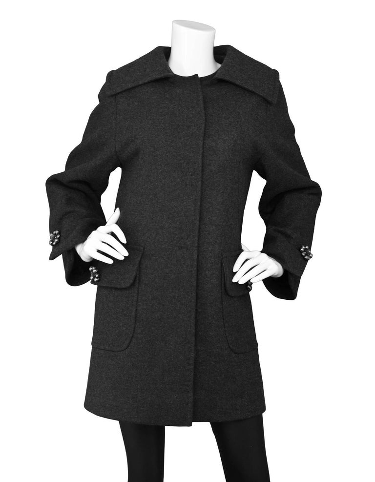Dolce & Gabbana Grey Wool Swing Coat Features crystal and faux pearl embellished buttons on pockets and cuffs  Made In: Italy Color: Grey Composition: Not given- believed to be 100% wool Lining: Black, silk Closure/Opening: Snap button down