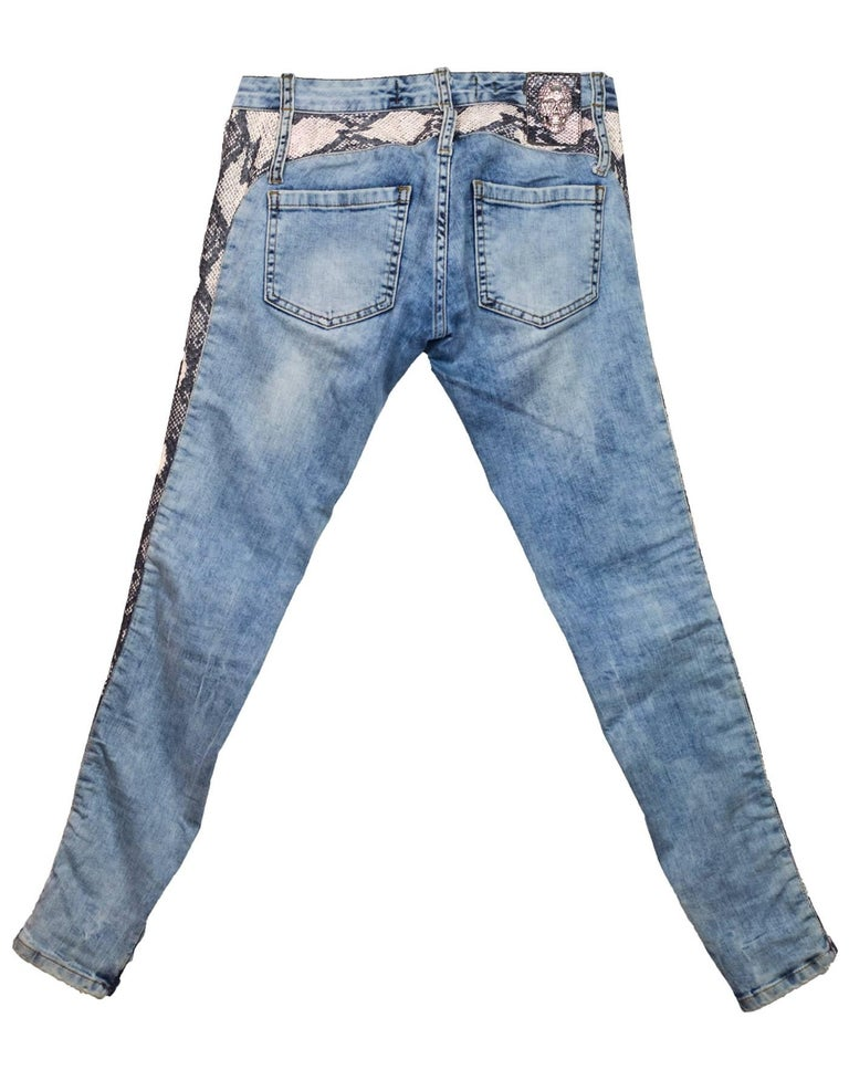Philipp Plein Snakeskin Jeans Sz 25 Features pink snakeskin print down legs, zippers at ankles  Made In: Turkey Color: Blue, pink Closure/Opening: Zip and button closure Composition: Cotton blend Exterior Pockets: Hip pockets and coin