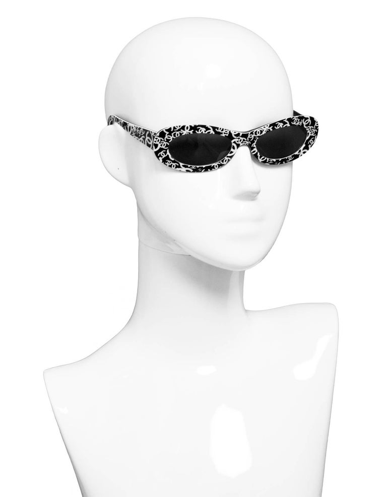 Chanel Vintage Black and Ivory CC Sunglasses  Made In: Italy Color: Black and ivory Materials: Resin Overall Condition: Very good pre-owned vintage condition with the exception of surface marks, misaligned hinges  Measurements:  Length Across: