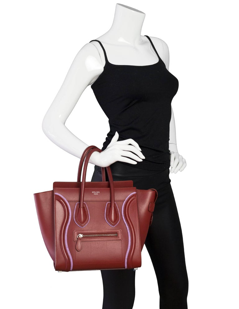 Celine Merlot & Purple Felt Micro Luggage Tote  Made In: Italy Color: Merlot, purple Hardware: Goldtone Materials: Leather, felt Lining: Merlot leather Closure/Opening: Zip top Exterior Pockets: One small zip pocket Interior Pockets: Two patch