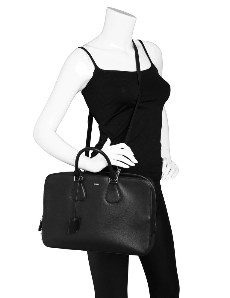 Bally Black Textured Leather Satchel Bag  Made In: Italy Color: Black Hardware: Silvertone Materials: Leather, metal Lining: Grey textile Closure/Opening: Zip across top Exterior Pockets: none Interior Pockets: One compartment, one zip