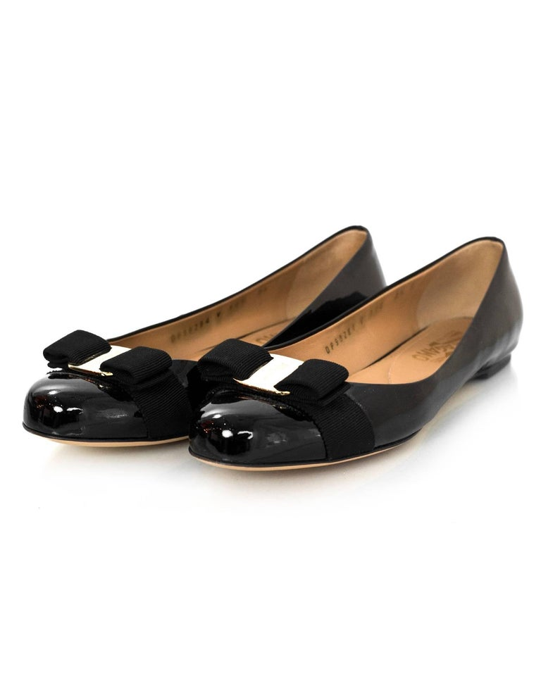 Salvatore Ferragamo Black Patent Leather Varina Bow Flats Sz 7.5C  *This shoe runs wide*  Made In: Italy Color: Black Materials: Patent leather Closure/Opening: Slide on Sole Stamp: Salvatore Ferragamo Made in Italy Retail Price: $550 + tax Overall