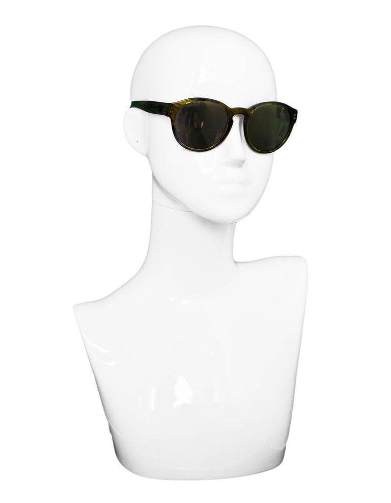 Chanel Green 5359 Pantos Fall Round Frame Sunglasses  Made In: Italy Color: Green Materials: Resin Retail Price: $405 + tax Overall Condition: Excellent pre-owned condition Included: Chanel box, case, dust bag, sales tag  Measurements:  Across: