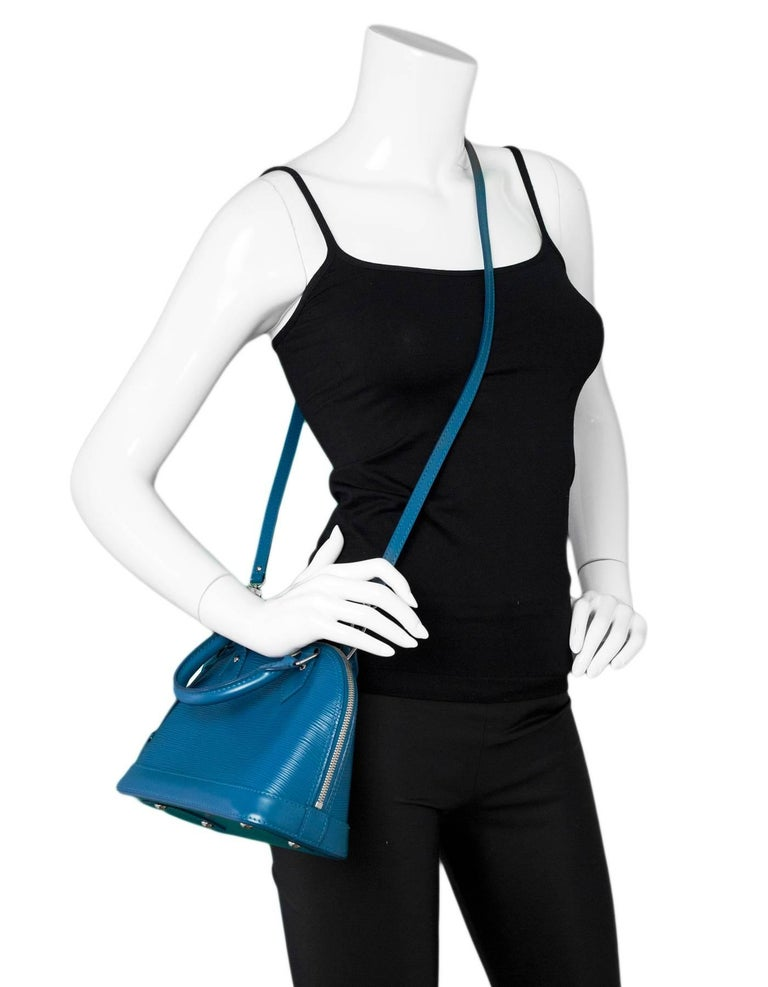 Louis Vuitton Cyan Blue Epi Alma BB Bag Features optional shoulder strap  Made In: France Year of Production: 2013 Color: Cyan blue Hardware: Silvertone Materials: Epi leather, metal Lining: Blue textile Closure/Opening: Double zip top