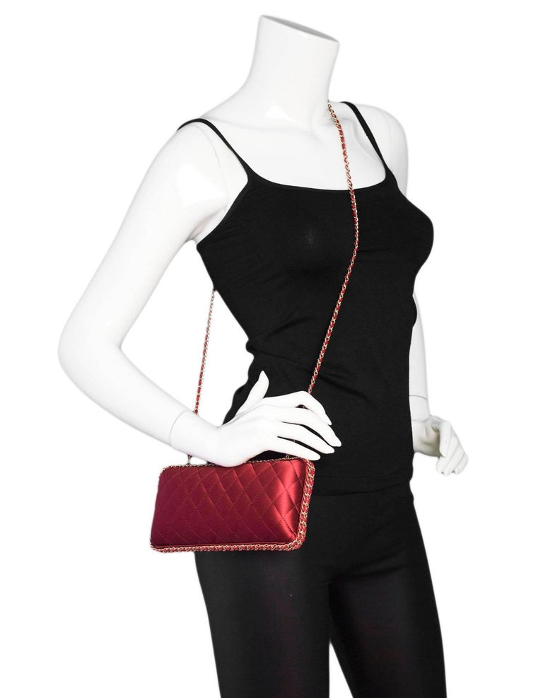 Chanel  Rust Red Quilted Satin Chain Around Box Clutch Features optional chain-link crossbody strap  Made In: Italy Color: Rust red Hardware: Goldtone Materials: Satin, metal, leather Lining: Rust red satin Closure/opening: CC snap top
