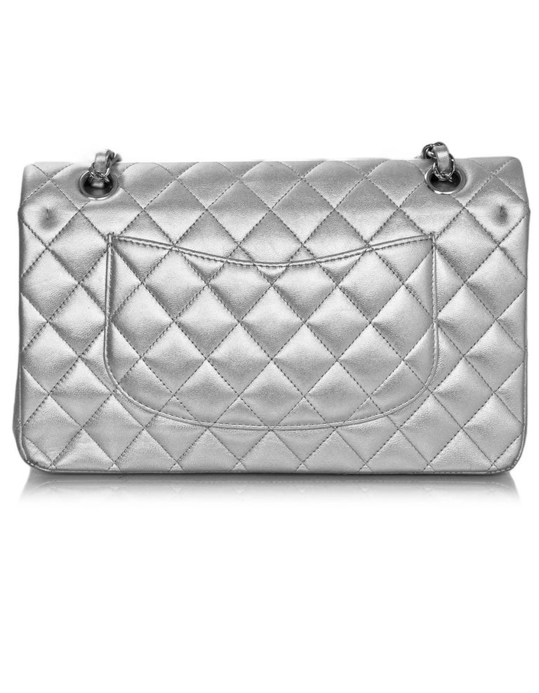 "Chanel Silver Quilted Lambskin 10"" Medium Double Flap Classic Bag  Made In: France Year of Production: 2010-2011 Color: Silver Hardware: Silvertone Materials: Lambskin, metal Lining: Silver leather Closure/opening: Flap top with CC twist"