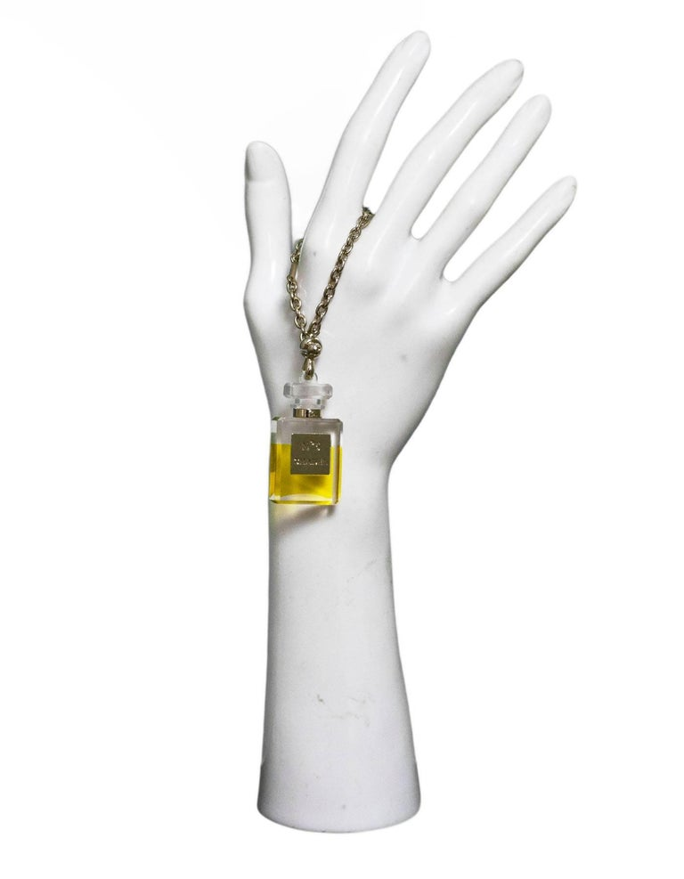 Chanel No5 Perfume Bottle Chain/Charm  Made In: Italy Year Of Production: 2005 Color: Clear, yellow, gold Materials: Resin, metal Closure: Ball closure Stamp: Chanel No5 Overall Condition: Excellent pre-owned condition, light surface marks Included: