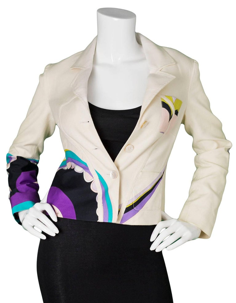 Emilio Pucci Beige & Multi-Colored Printed Jacket Features multi-colored design throughout   Made In: Italy Color: Beige, green, purple, black, pink, turquoise Composition: 70% cotton, 30% silk Lining: Beige, 100% polyester Closure/Opening:
