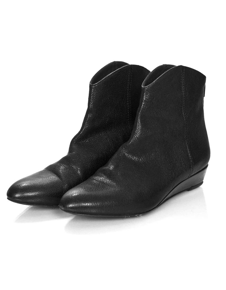 Stuart Weitzman Black Leather Ankle Boots Sz 6  Made In: Spain Color: Black Materials: Leather Closure/Opening: Back zip closure Sole Stamp: Stuart Weitzman Made in Spain Overall Condition: Excellent pre-owned condition with the exception of light