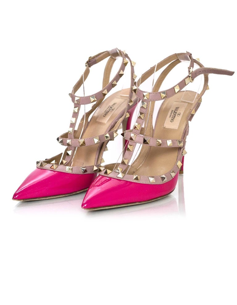 Valentino Pink Patent Rockstud 100mm Pumps Sz 40  Made In: Italy Color: Pink Retail Price: $995 + tax Materials: Patent leather, leather, metal Closure/Opening: Buckle closure at ankle Sole Stamp: Valentino Garavani Made in Italy 40 Overall