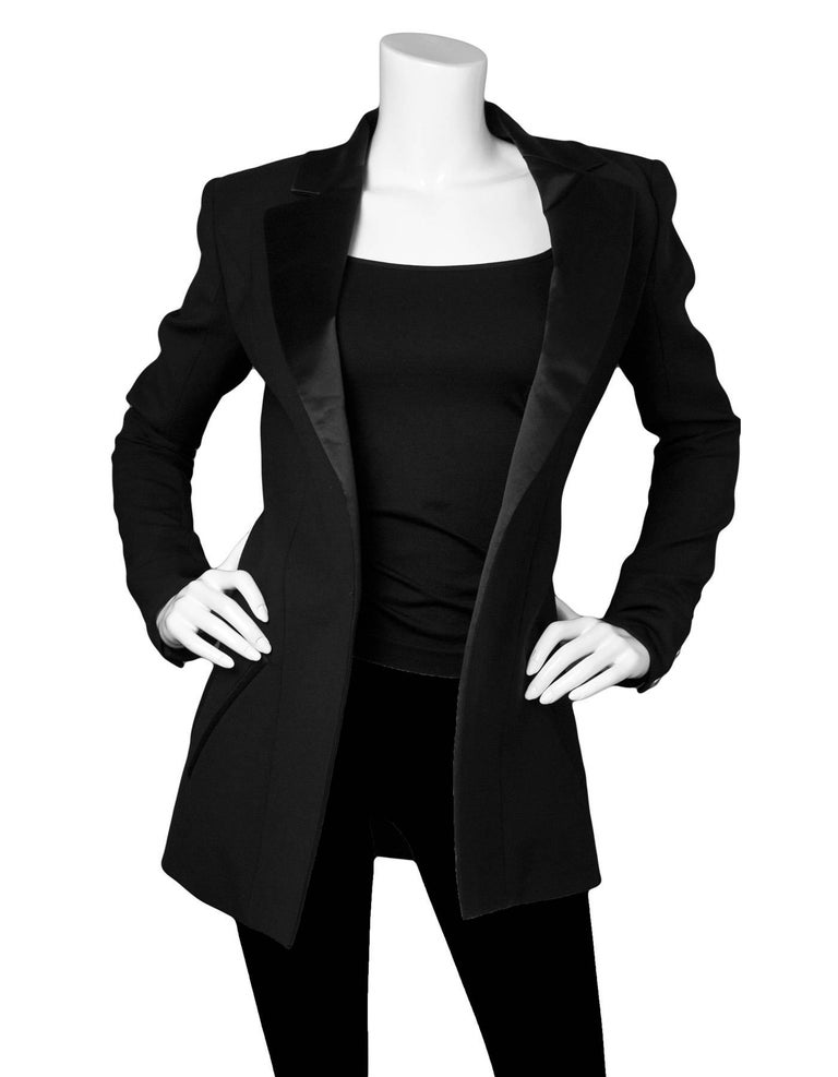 Balmain Black Wool Open Front Blazer  Features satin trim  Made In: France Color: Black Composition: 95% wool, 5% elastane Lining: Black, 52% viscose, 48% cupro Closure/Opening: None- Open front Exterior Pockets: Five faux pockets Interior Pockets: