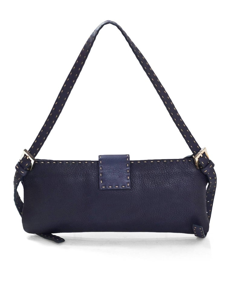 Fendi Navy Leather Selleria Bag  Features contrast stitching  Made In: Italy Colors: Navy Hardware: Silvertone  Materials: Leather, metal Lining: Beige textile Closure/Opening: Zip top closure with center snap flap Exterior Pockets: None Interior