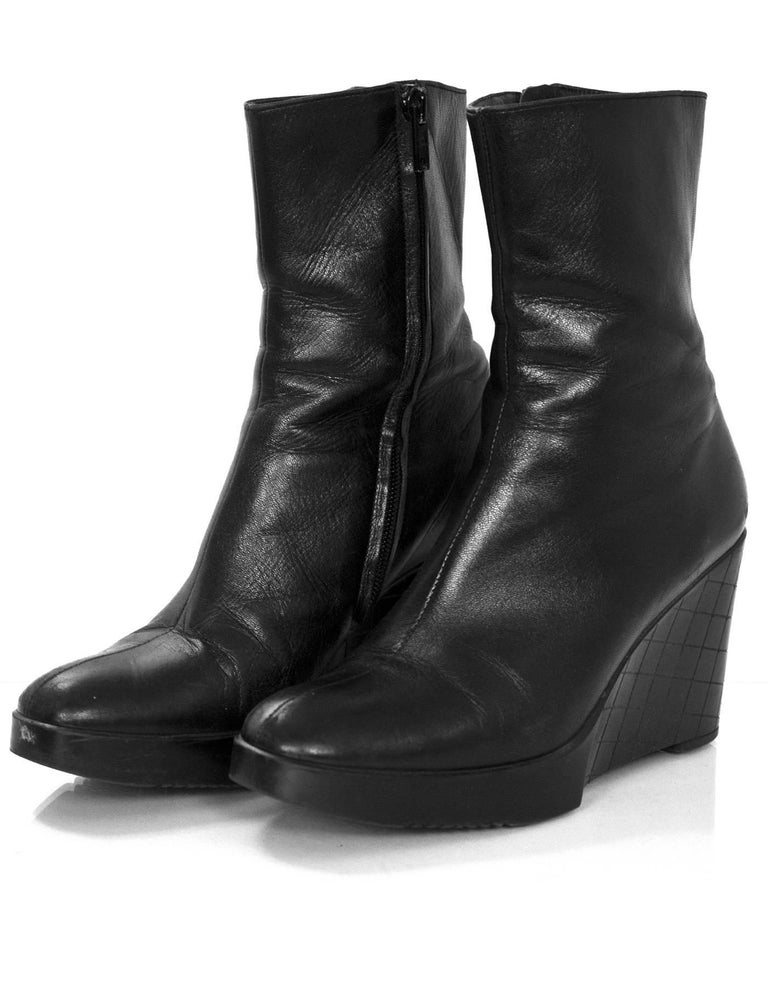 Robert Clergie Black Leather Wedge Ankle Boots Sz 6.5  Made In: France Color: Black Materials: Leather Closure/Opening: Sisde zip closure Sole Stamp: Robert Clergie Made in France Overall Condition: Very good pre-owned condition with the exception