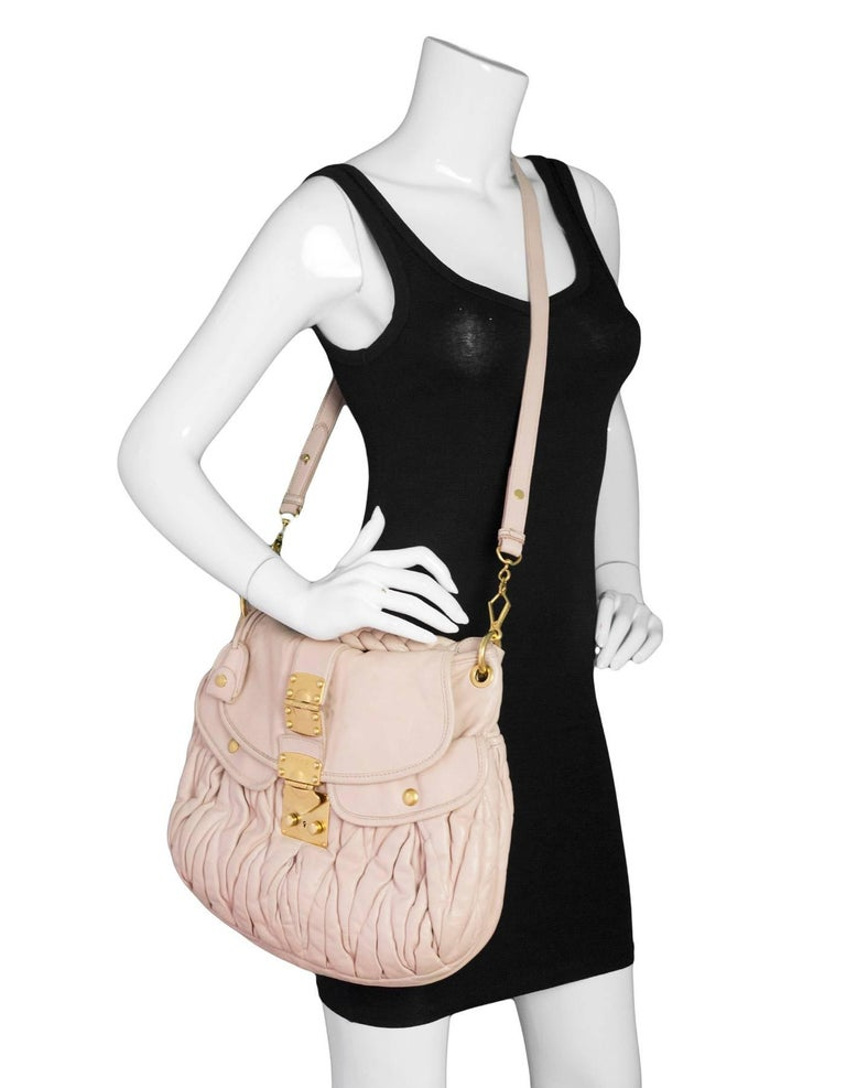 Miu Miu Blush Matelasse Lambskin Coffer Satchel  Made In: Turkey Color: Blush pink Hardware: Goldtone Materials: Leather, metal Lining: Brown textile Closure/Opening: Flap top with push-lock closure Exterior Pockets: Two flap pockets Interior