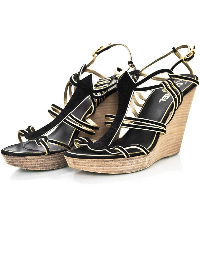 Chanel Black Suede Wedge Sandals Sz 40  Features gold trim  Made In: Italy Color: Black, gold, brown Materials: Suede Closure/Opening: Buckle closure at ankle Sole Stamp: CC Made in Italy 40 Overall Condition: Very good pre-owned condition with the